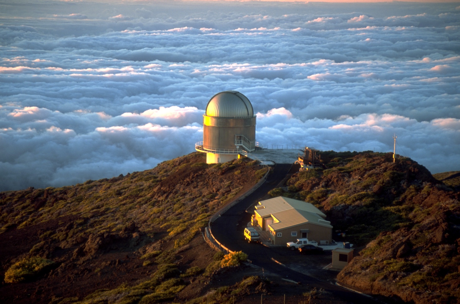 The Nordic Optical Telescope (NOT) telescope at Roque de los Muchachos Observatory in June 2001, by Bob Tubbs, via Wikimedia Commons
