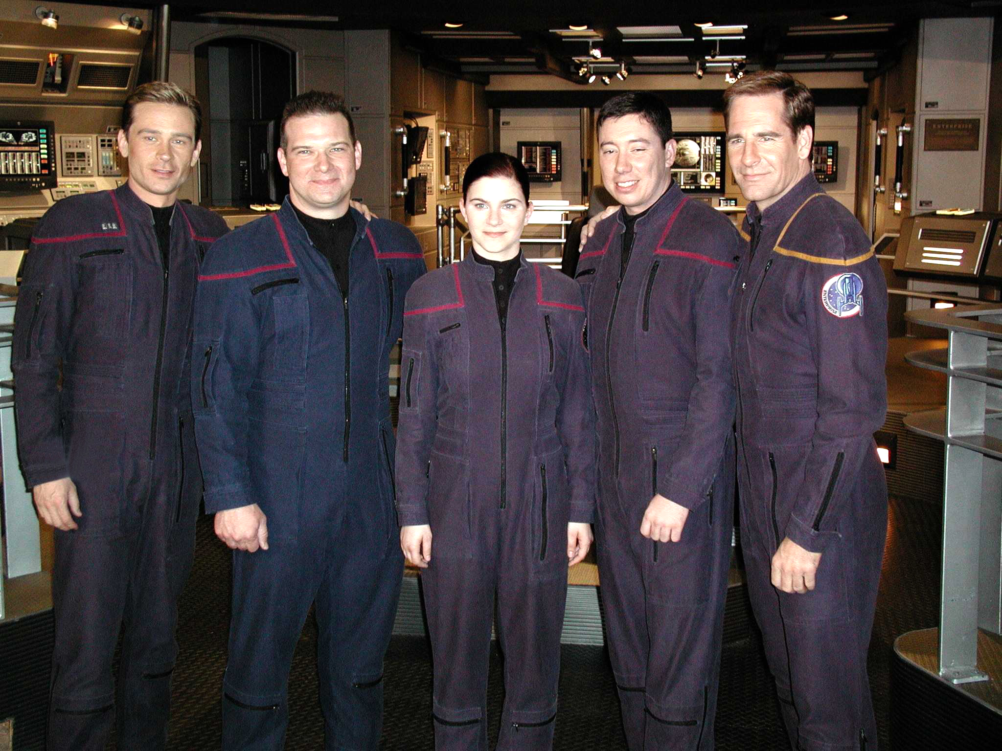 "Sailors of the Year for the year 2001 meet cast members of the 'Star Trek' television series entitled ""Enterprise."" Pictured here on the set of the series are (from left) Conner Trinneer, who plays Chief Engineer Charles ""Trip"" Tucker, III; Aviation Electronics Technician 1st Class Robert S. Pickering, Sailor of the Year; Personnelman 3rd Class Sarah E. Pizzo, Blue Jacket of the Year; Aviation Electrician's Mate 2nd Class Timothy J. Whittington, Junior Sailor of the Year; and Scott Bakula, who plays Capt. Jonathan Archer. The three Sailors were given the opportunity to appear in a scene during an episode which aired recently."