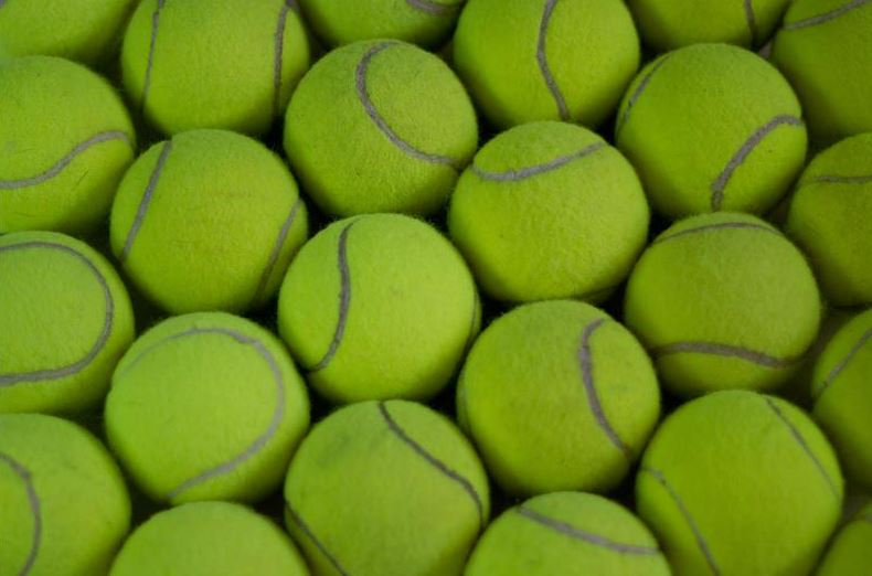 How Many Ways Can You Arrange 128 Tennis Balls? An Apparently Impossible Problem Solved